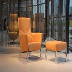 Design fauteuil Living in leer van Ojee Design met Hocker